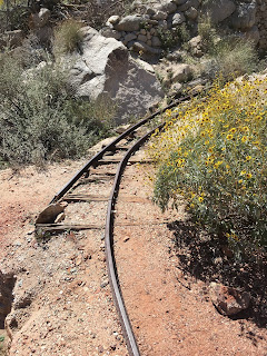 Narrow gauge rails lead from mine to tailing pile