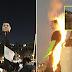 Queman y cortan cabeza de figura de Peña Nieto afuera del Palacio Nacional