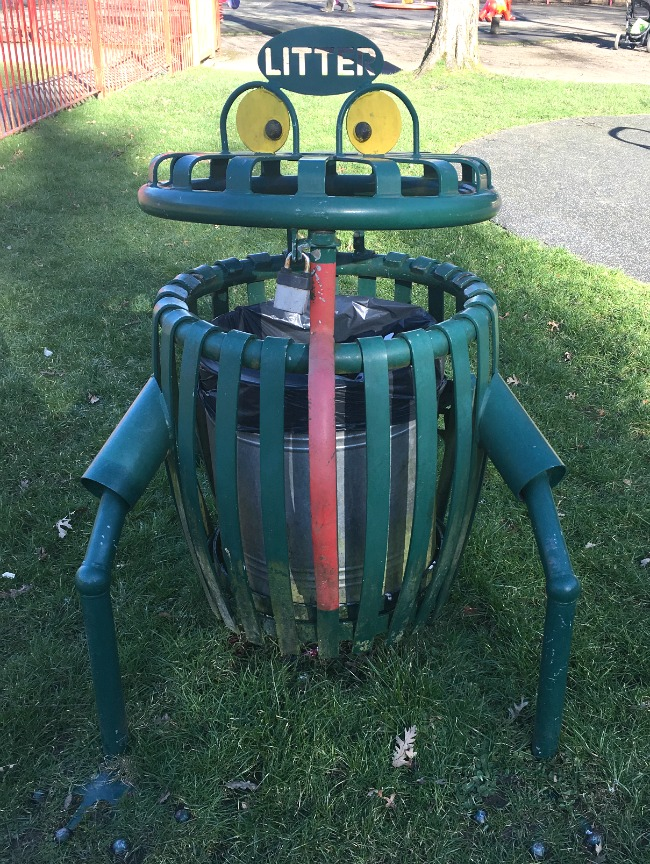 green-litter-bin-in-morgan-jones-park-caerphilly-it-has-eyes-and-legs-and-looks-like-a-rubbish-eating-beast.