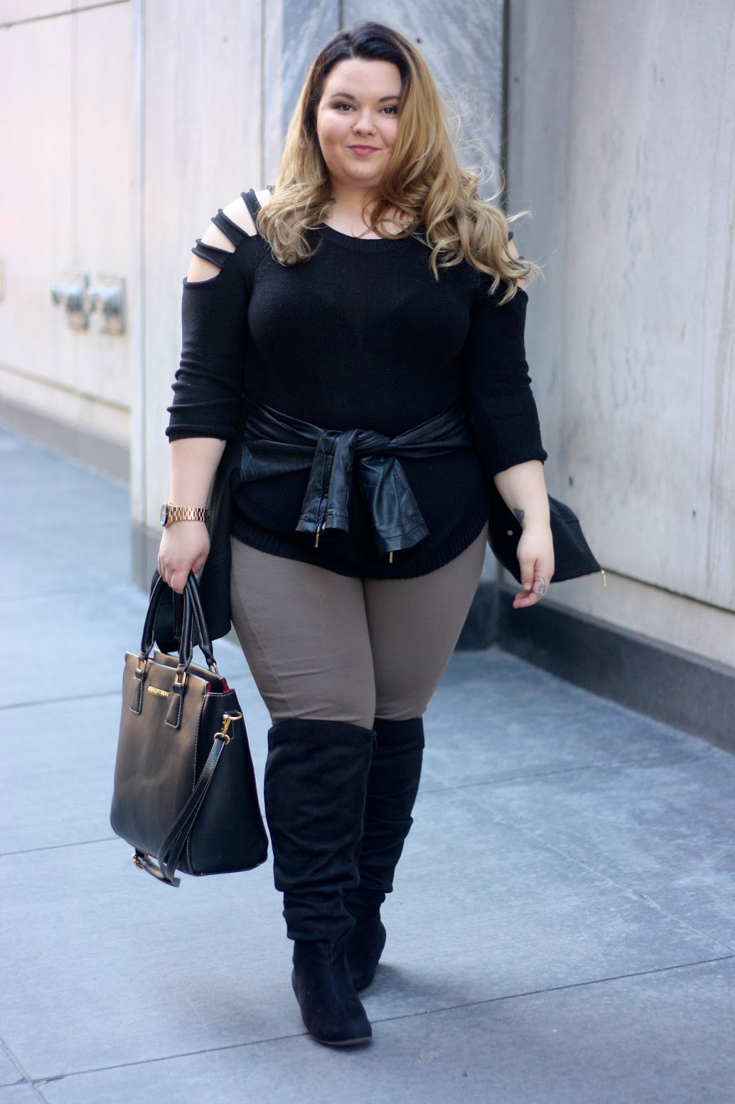 plus size knee high boots, CUT OUT SHOULDERS, plus size sweaters, leather tie waist, leather jacket around waist, beige leggings, plus size fashion, natalie craig, natalie in the city, cut out sweaters, fashion blogger, quay eyewear, quay