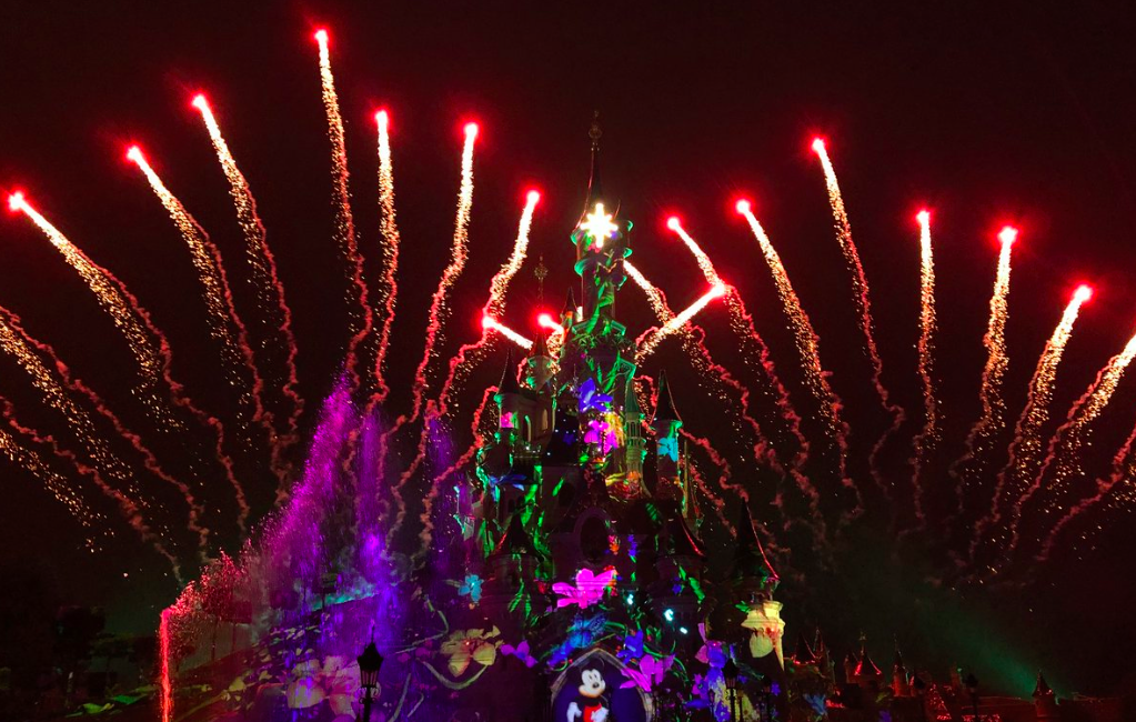 This is a picture of the Disneyland Paris castle with fireworks
