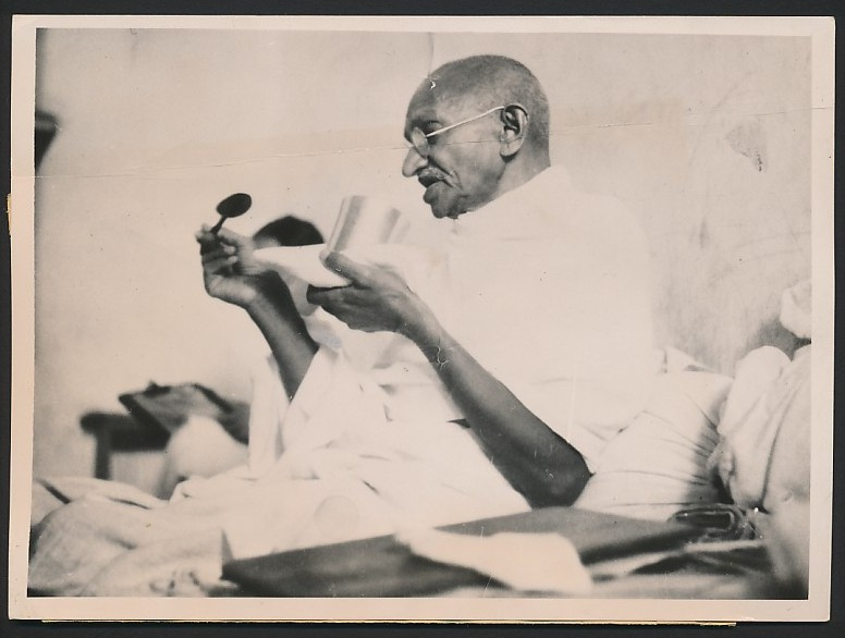 Mahatma Gandhi taking his last meal before the start of ...