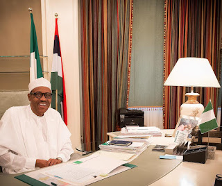 Photo.  President Buhari resumes work