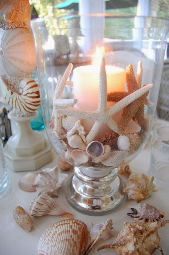 seashell bouquet Beach themed table setting with shell candle as wedding centerpiece