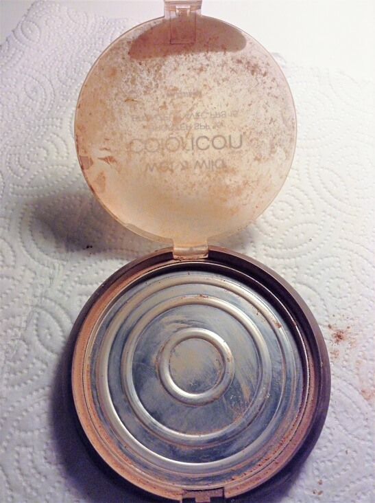 cleaning out an empty makeup pan