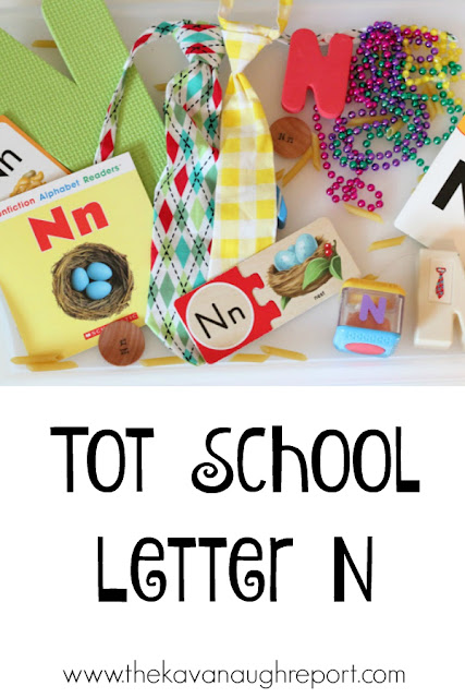 Tot school trays for the letter n. This theme explores numbers, names, nests and nuts!
