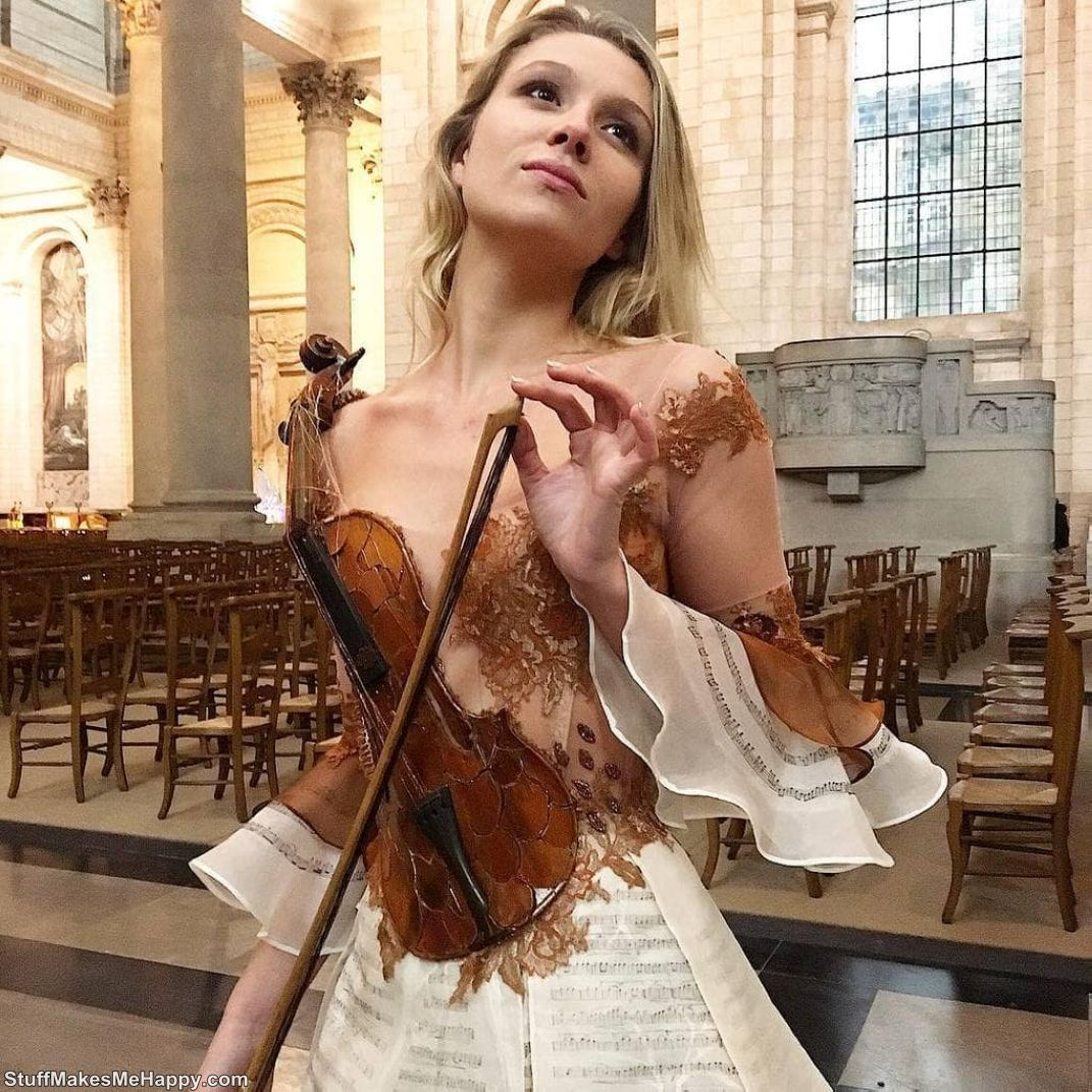 Dress-violin with pages from a music notebook