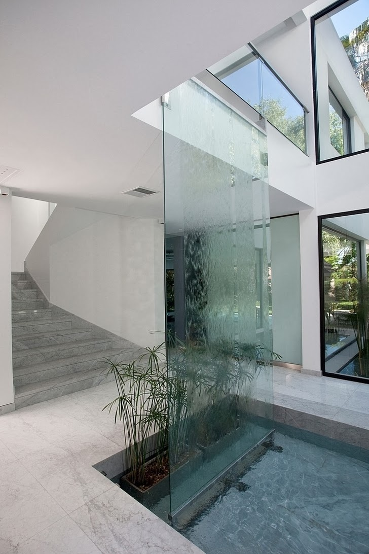 Waterfall in Minimalist Casa Carrara by Andres Remy Architects