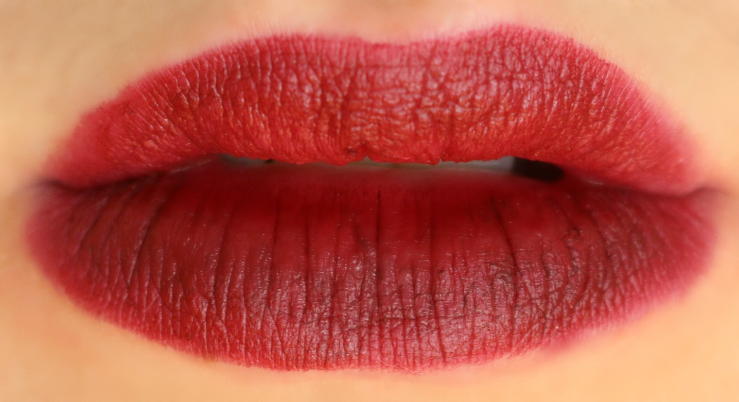 charlotte tilbury matte revolution lipstick opium noir lip swatch