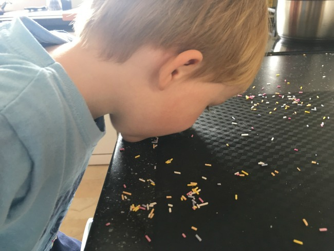 toddler-eating-sprinkles-directly-off-the-work-surface