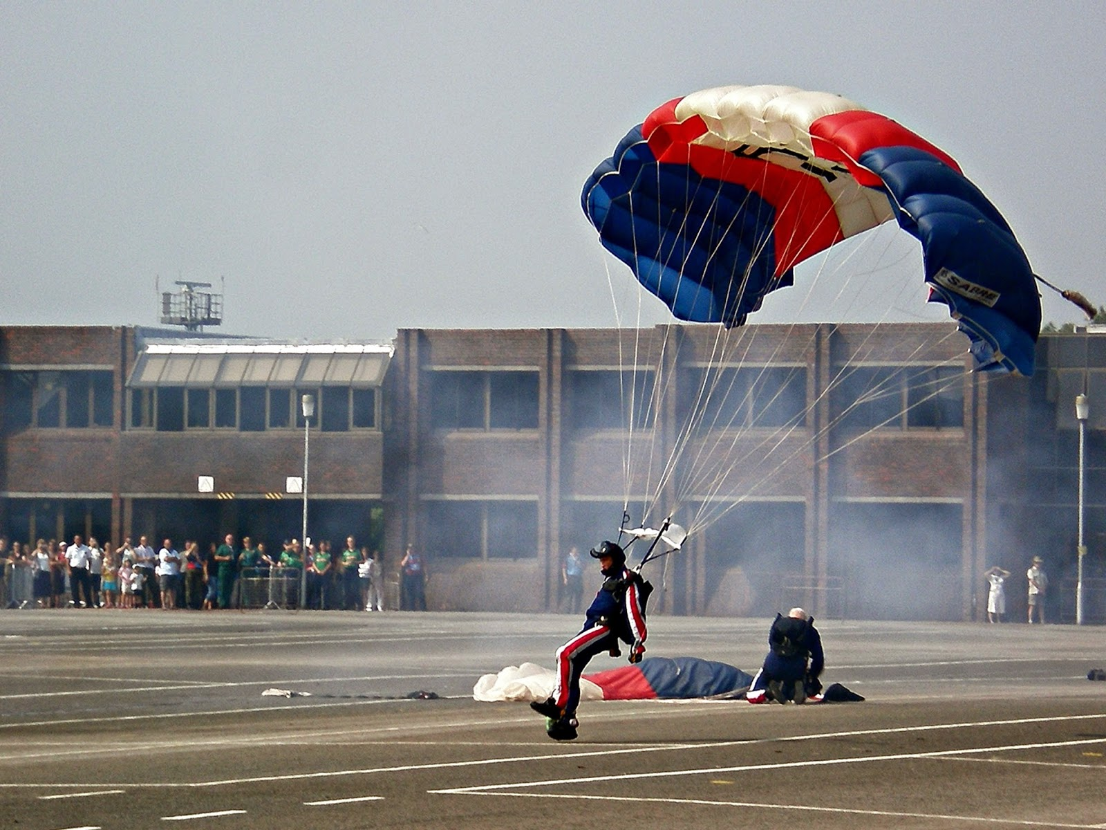 A parachutist lands on the HMS Collingwood parade ground