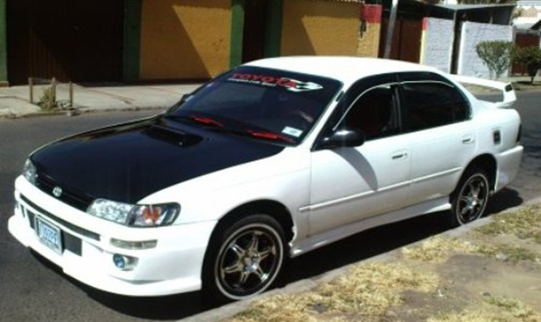 Custom toyota corolla white is designed with white car paint here you can also see custom wheel with five spokes aluminum look this design of custom