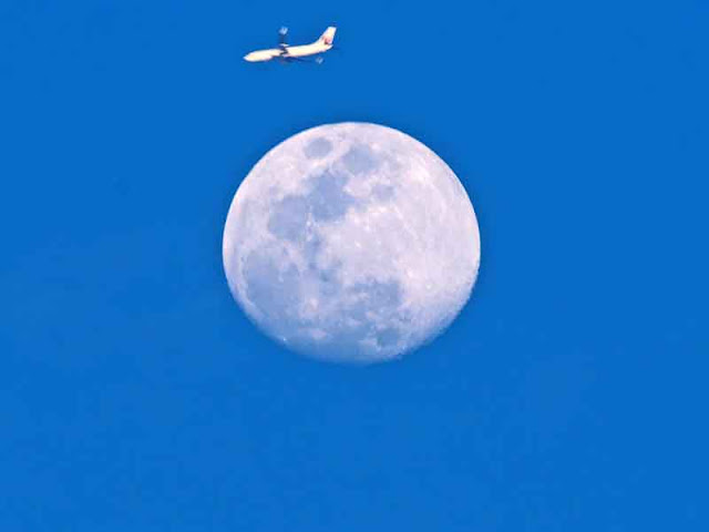 Airline flying over moon on MAY 8  2017, Okinawa