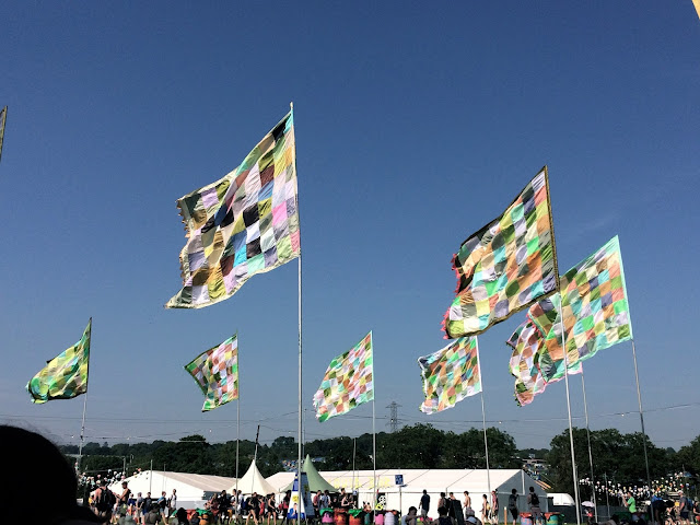 Colourful flags at Glastonbury Festival