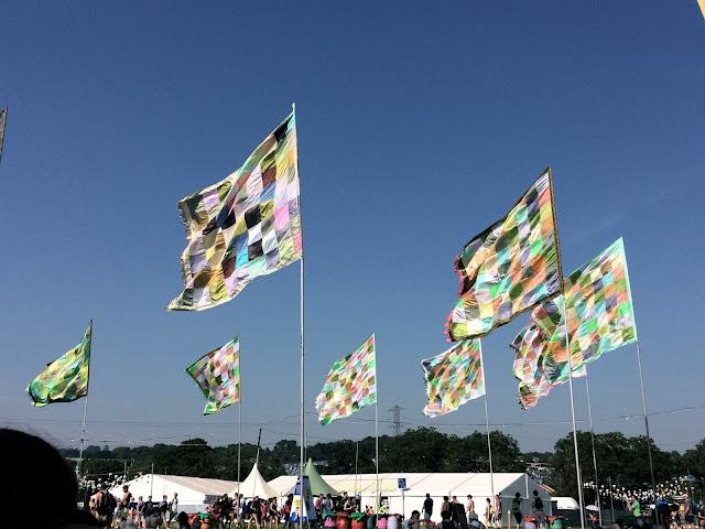 Colourful flags at Glastonbury Festival