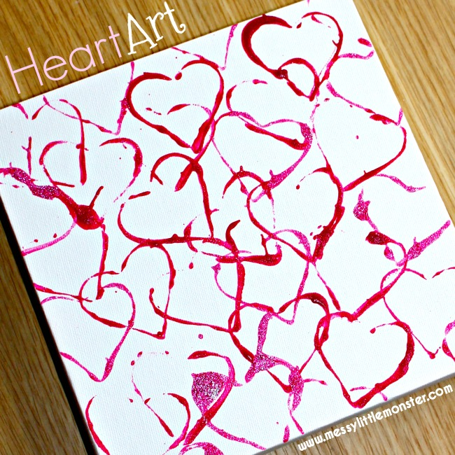 Cookie cutter heart art for toddlers and preschoolers. An easy kids process art activity. 'The day it rained hearts' craft.