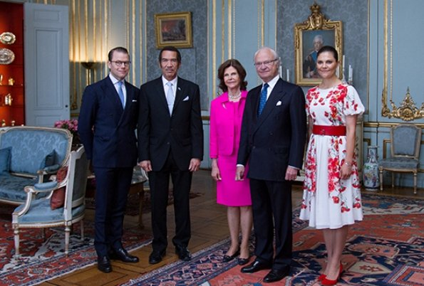 Crown Princess Victoria in a red and white flower dress meeting with the President of Botwana Ian Khama at the Royal Palace