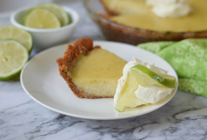 Key lime pie made with graham cracker crust and the most delicious and refreshing filling. Key Lime Pie is a perfect addition to any celebration!