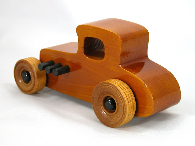 Left Rear - Wooden Toy Car - Hot Rod Freaky Ford - 27 T Coupe - Pine - Amber Shellac - Black Hubs