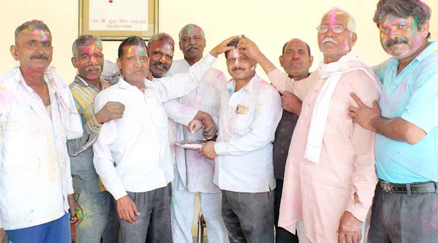 Bhopani Sarpanch Sanjay Bhati celebrates Holi with villagers