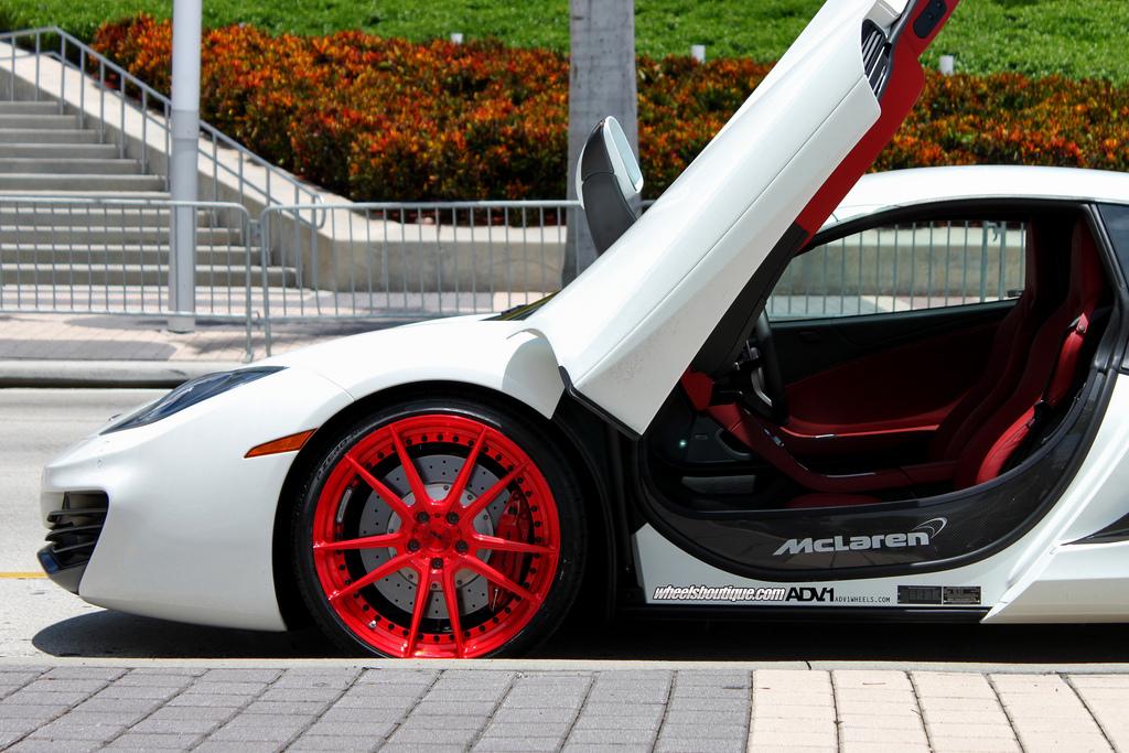 mclaren mp4-12c sitting on adv.1 wheels which do not work