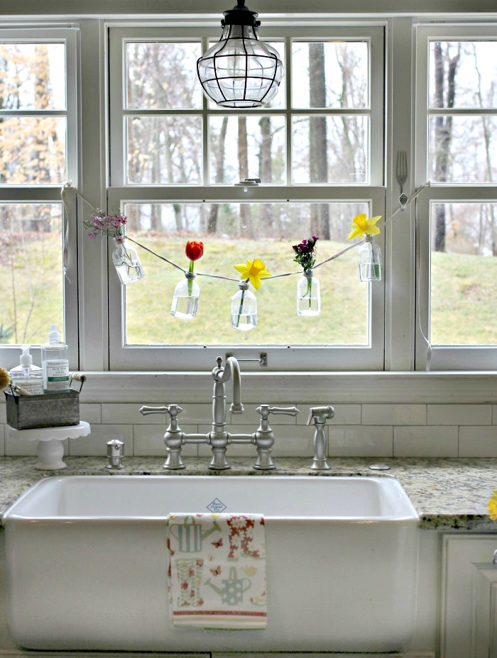 Shaw's farmhouse fireclay sink with Graff bridge faucet and industrial pendant - www.goldenboysandme.com