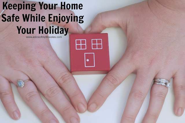 hands forming heart around red toy house - Keeping Your Home Safe While Enjoying Your Holiday blog post with top tiops