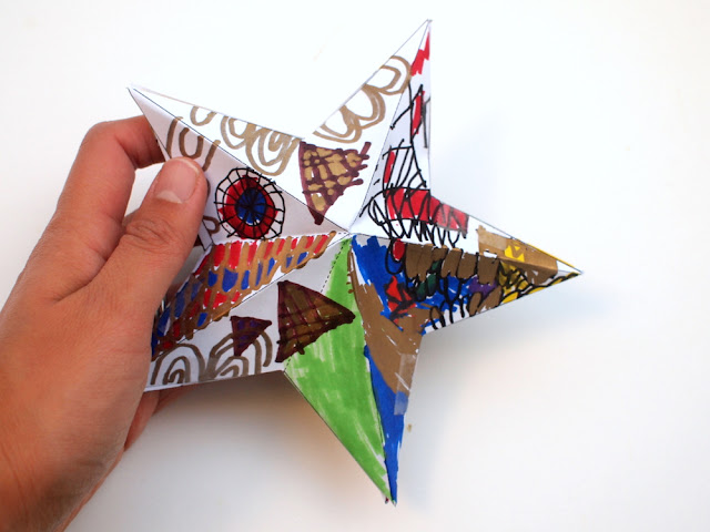 Doodle some designs on these awesome 3D paper Christmas Stars- great Kids art project