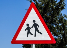 Children's crossing traffic sign.