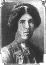 A portrait of a young white woman of the turn of the 20th century, with very thick, dark hair in an updo.