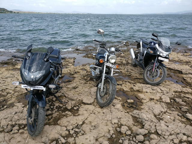 bikes parked on the shore of backwaters of a dam