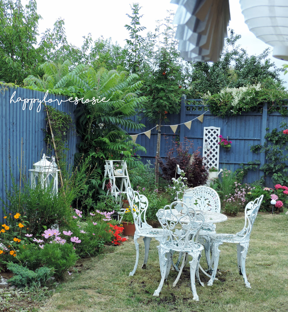 vintage metal furniture in cottage garden