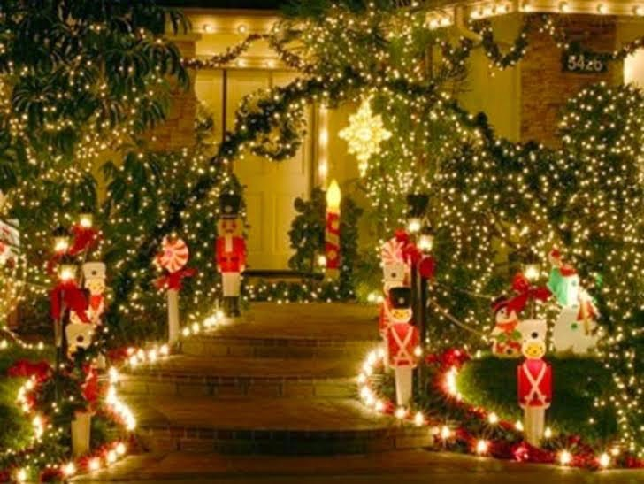 Holiday decorations make for an inviting front door and walkway.
