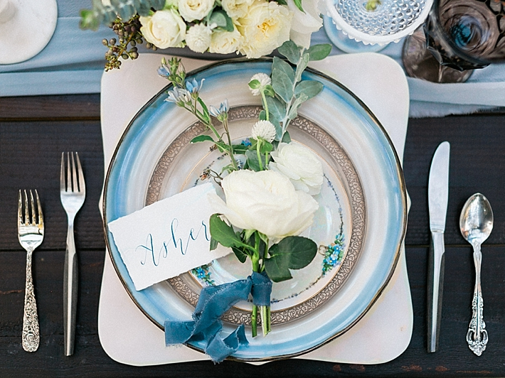 Elegant place settings on top of marble chargers with calligraphy name cards | Photo by Dennis Roy Coronel | See more on thesocalbride.com