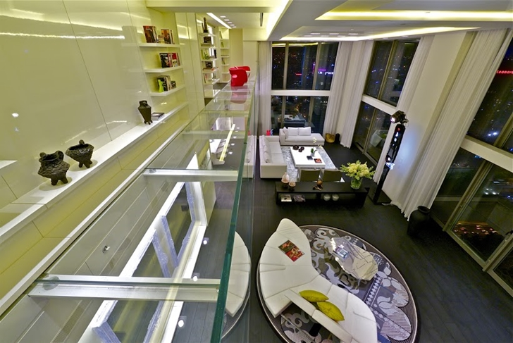Glass bridge above penthouse living room
