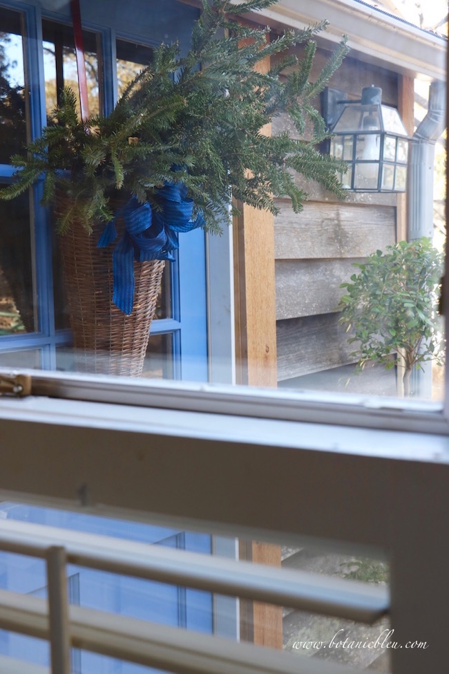exterior-willow-basket-christmas-greenery-visible-inside-window