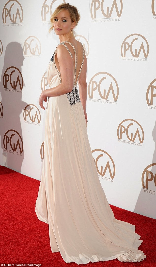 Jennifer Lawrence dazzles in a plunging Prada dress at the 2015 Producers Guild of America Awards in LA