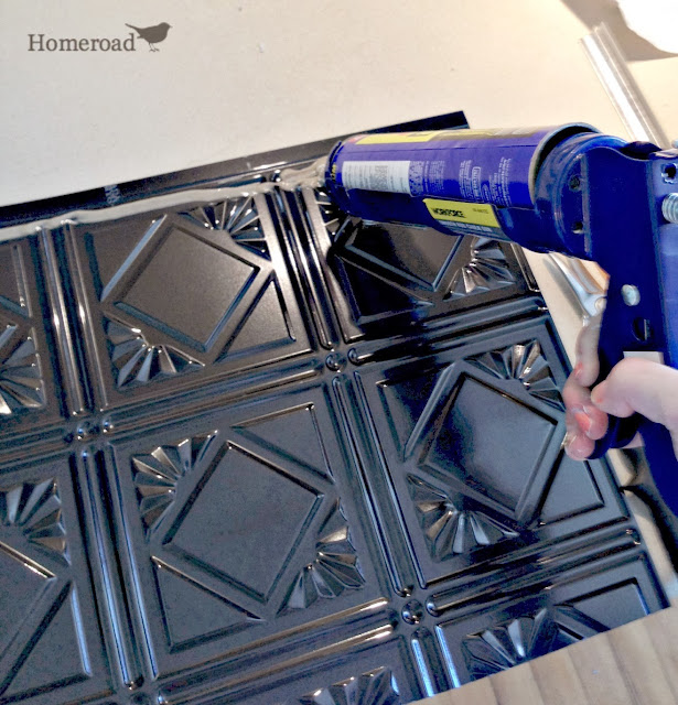 adding adhesive to tin ceiling backsplash www.homeroad.net