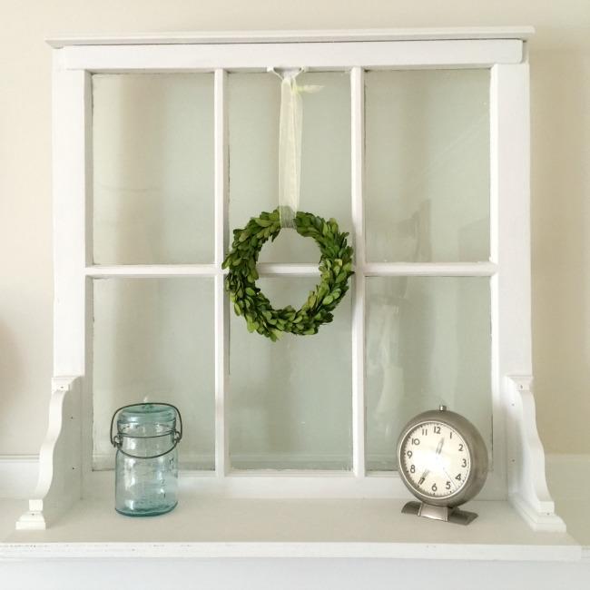 Window shelf with mason jar and clock