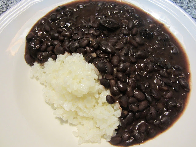 Food Lust People Love: A traditional meal in the Carioca, that is to say Rio de Janeiro - area of Brazil, black beans with sausage and rice is a tasty staple that will fill you up and bring you comfort. Best of all, it's easy to make!