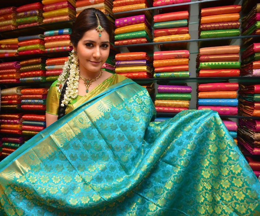Rashi Khanna Stills In Green Color Saree