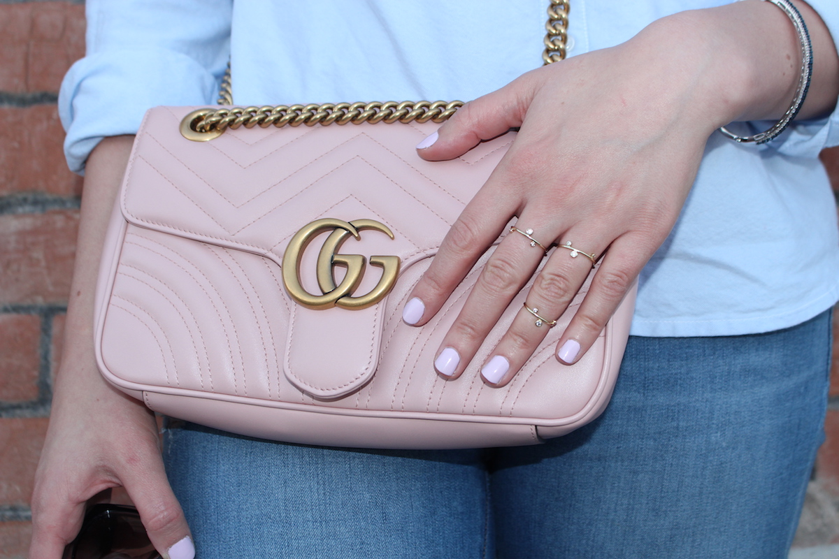 This is a close-up of my accessories, include my pink Gucci bag, pink nails and my rings and bracelet.
