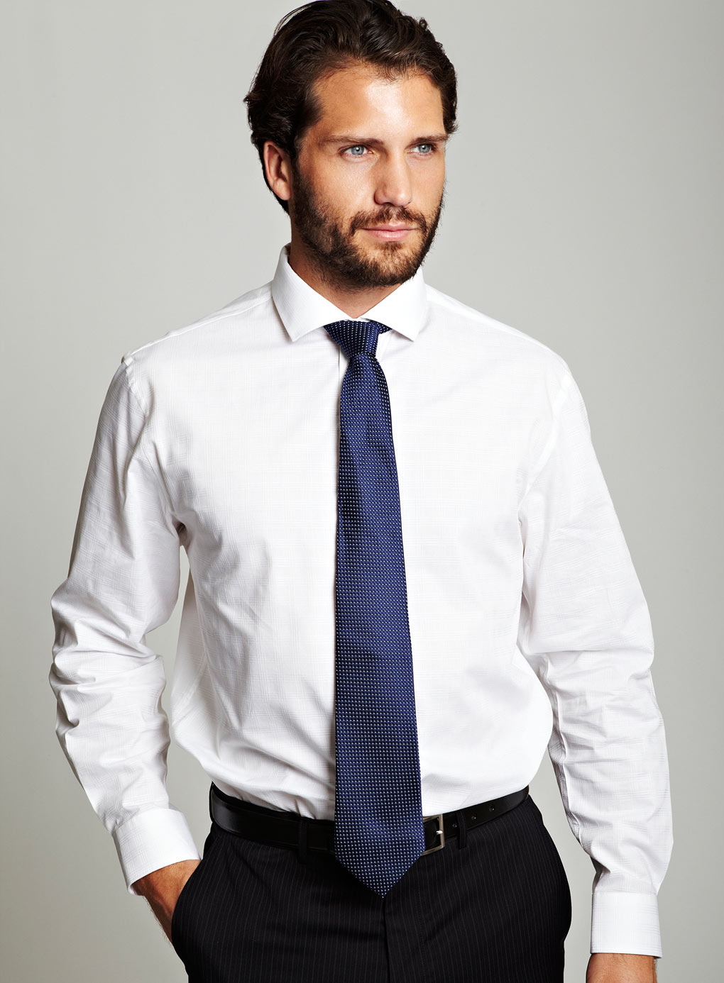 Sexy guy in a white shirt and tie