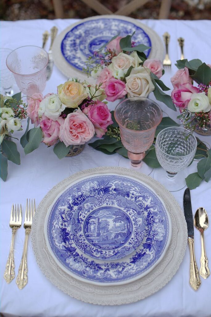 Blue And White Dishes On Table For Dinner