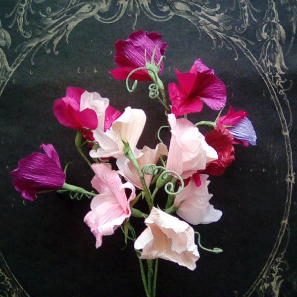 Cluster of sweet pea crepe paper flowers on vintage black tray