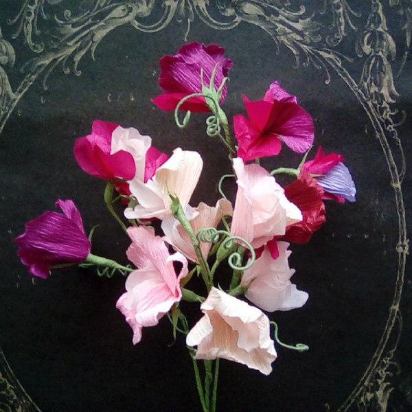 Cluster of sweet pea crepe paper flowers on vintage black tray