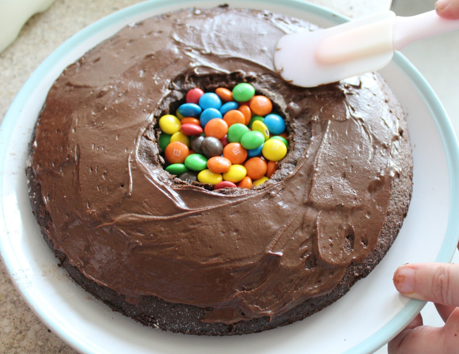 Cake With Icing Baked Inside : Little Boy Bakes: M & M s Surprise Inside Chocolate Fudge ...