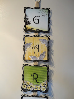 Part of wall hanging, 3 squares with the letters G, A, R, each decorated with a garden theme