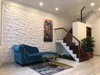 Cầu thang bố trí 1 góc gọn gàng và hài hòa, tạo nên không gian rộng rãi cho căn nhà hẻm đường Quang Trung phường 10 quận Gò vấp