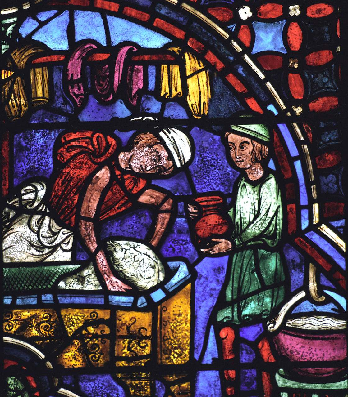 Tintureiros. O aprendiz aprende o ofício auxiliando o mestre. Vitral dos Apóstolos, catedral de Chartres, França.